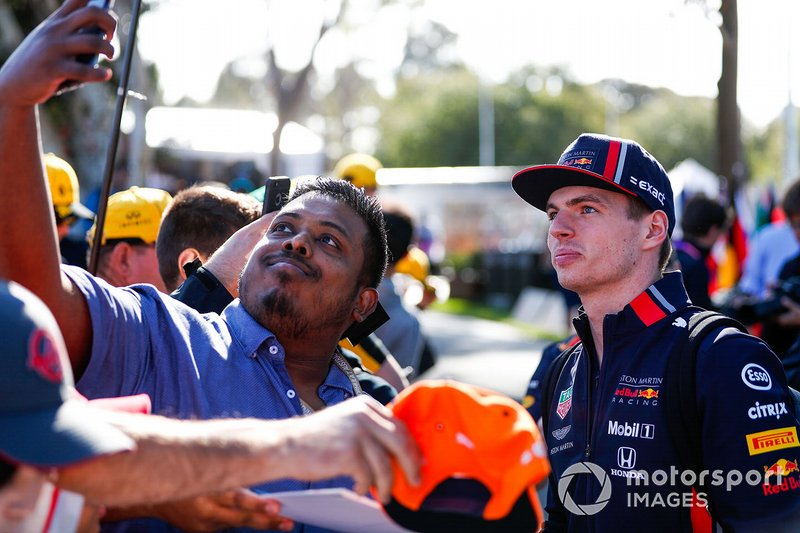 Max Verstappen, Red Bull Racing, takes a selfie with a fan