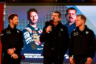 Romain Grosjean, Haas F1 Team, Guenther Steiner, Team Principal, Haas F1 and Kevin Magnussen, Haas F1 Team on stage at the Federation Square event
