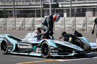 Mitch Evans climbs out of his Panasonic Jaguar Racing, Jaguar I-Type 3 on the grid