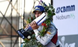 Race winner Lucas Di Grassi, Audi Sport ABT Schaeffler kisses his trophy on the podium