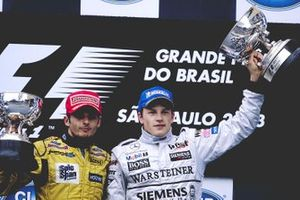Race podium, winner Kimi Raikkonen, McLaren, second place Giancarlo Fisichella, Jordan