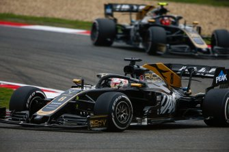 Romain Grosjean, Haas F1 Team VF-19, leads Kevin Magnussen, Haas F1 Team VF-19