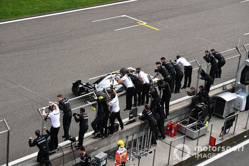 Valtteri Bottas, Mercedes AMG W10, 2nd position, passes the Mercedes pit wall