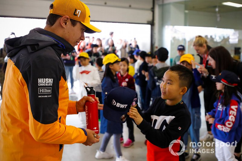 Lando Norris, McLaren with grid kids