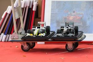1:8 Scale models of Brawn and Mercedes F1 cars on a trolley