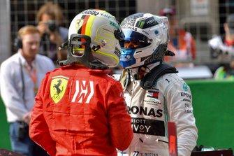 Sebastian Vettel, Ferrari, congratulates pole man Valtteri Bottas, Mercedes AMG F1,