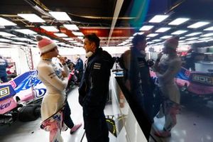 Lance Stroll, Racing Point, talks to Andy Stevenson, Sporting Director, Racing Point, in the team's garage