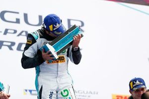 Cacá Bueno, Jaguar Brazil Racing, kisses his winner's trophy on the podium