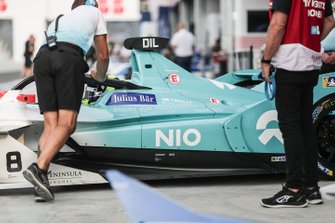 Tom Dillmann, NIO Formula E Team, NIO Sport 004, is pushed into the garage by mechanics