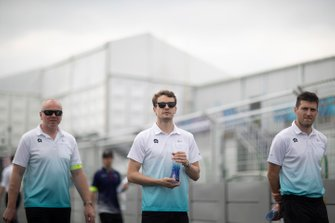 Tom Dillmann, NIO Formula E Team, walks the track with team members