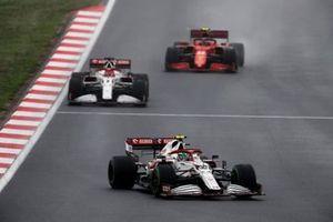 Antonio Giovinazzi, Alfa Romeo Racing C41, Kimi Raikkonen, Alfa Romeo Racing C41, and Carlos Sainz Jr., Ferrari SF21