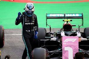 Pole man Valtteri Bottas, Mercedes, celebrates on arrival in Parc Ferme
