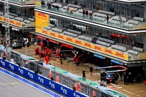 Carlos Sainz Jr., Ferrari SF21, and Fernando Alonso, Alpine A521, in the pit lane