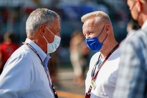 Chase Carey, Non Executive Chairman, Formula One, and Dmitry Mazepin on the grid