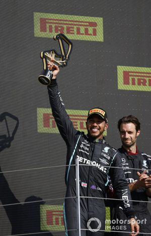 Lewis Hamilton, Mercedes, 1st position, on the podium with his trophy