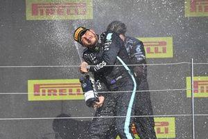 Lewis Hamilton, Mercedes, 1st position, celebrates with his team mate on the podium