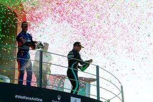 Daniel Ricciardo, McLaren, 1st position, and Valtteri Bottas, Mercedes, 3rd position, spray Champagne from the podium