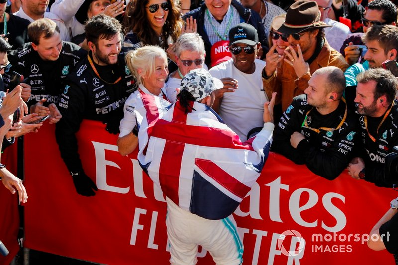 Lewis Hamilton, Mercedes AMG F1, 2nd position, celebrates with his team, his father Anthony Hamilton and actor Matthew McConnaughey after securing his sixth world title