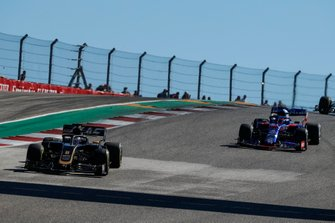 Romain Grosjean, Haas F1 Team VF-19, leads Pierre Gasly, Toro Rosso STR14
