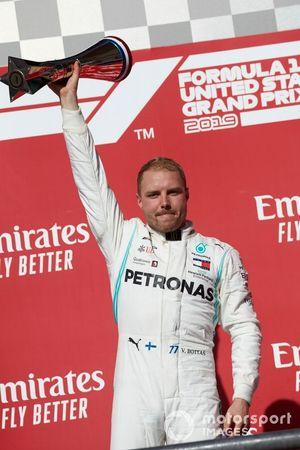 Valtteri Bottas, Mercedes AMG F1, lifts his winner's trophy