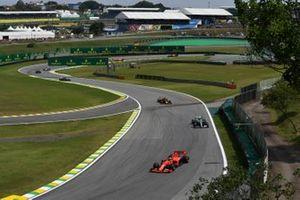 Sebastian Vettel, Ferrari SF90, leads Valtteri Bottas, Mercedes AMG W10, and Alexander Albon, Red Bull RB15