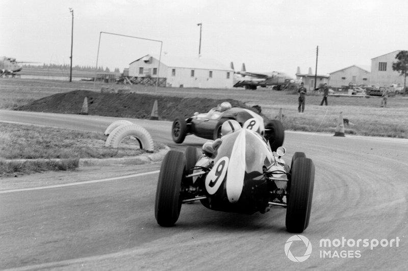 Jack Brabham, Cooper T51 Climax, leads Bruce McLaren, Cooper T51 Climax