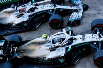 Valtteri Bottas, Mercedes AMG W10, 1st position, and Lewis Hamilton, Mercedes AMG F1 W10, 3rd position, arrive in Parc Ferme