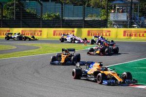 Carlos Sainz Jr., McLaren MCL34 , leads Lando Norris, McLaren MCL34, Alex Albon, Red Bull RB15, Pierre Gasly, Toro Rosso STR14, and Lance Stroll, Racing Point RP19