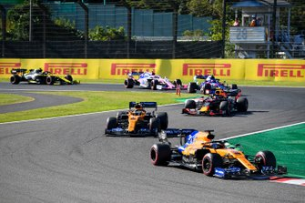 Carlos Sainz Jr., McLaren MCL34 , leads Lando Norris, McLaren MCL34, Alex Albon, Red Bull RB15, Pierre Gasly, Toro Rosso STR14, and Lance Stroll, Racing Point RP19