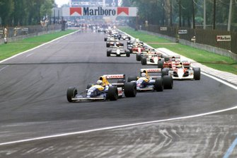 Riccardo Patrese, Williams FW14 Renault, leads Nigel Mansell, Williams FW14 Renault, and Ayrton Senna, McLaren MP4-6 Honda, at the start of the race