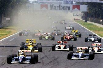 Nigel Mansell, Williams FW14B Renault, leads Riccardo Patrese, Williams FW14B Renault, Martin Brundle, Benetton B191B Ford, Gerhard Berger, McLaren MP4-6B Honda, and Ayrton Senna, McLaren MP4-6B Honda, at the start