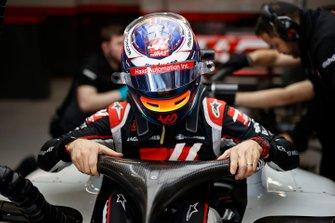 Romain Grosjean climbs into his Haas VF-20