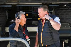 Mario Andretti on the pit wall with Zak Brown, Executive Director, McLaren