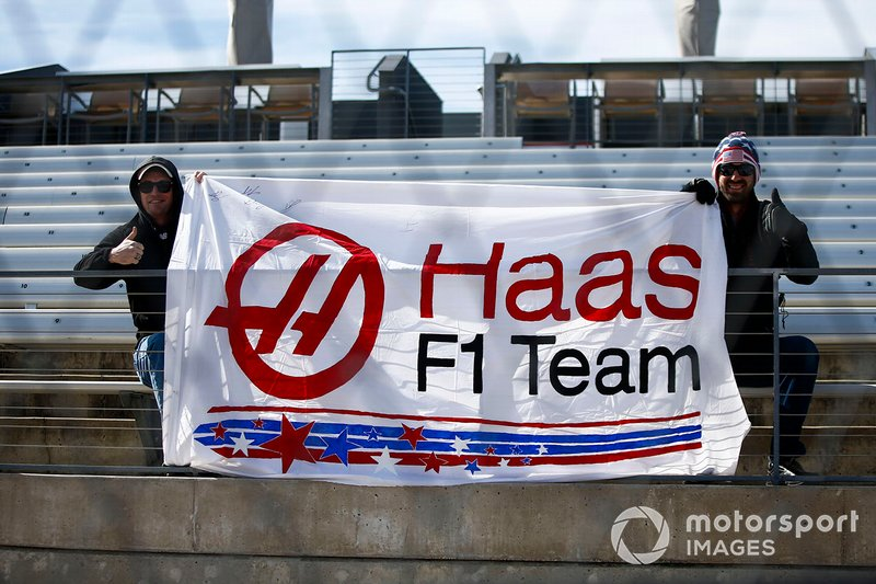 Fans hold a Haas banner