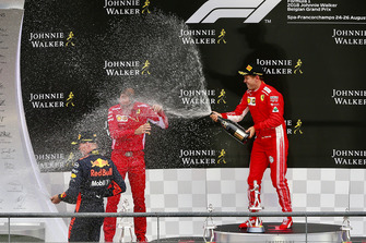 Sebastian Vettel, Ferrari celebrates on the podium with champagne at David Sanchez, Ferrari