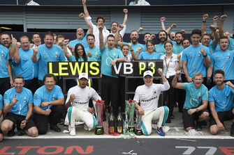 Lewis Hamilton, Mercedes AMG F1, Valtteri Bottas, Mercedes AMG F1, and colleagues, including Toto Wolff, Executive Director (Business), Mercedes AMG, celebrate victory