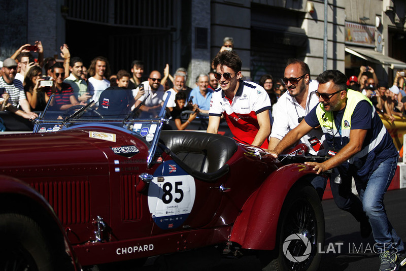 Charles Leclerc, Sauber helps push a vintage car