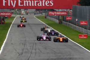 Fernando Alonso, McLaren MCL33 and Sergio Perez, Racing Point Force India VJM11 battle