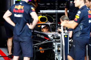 Pierre Gasly, Toro Rosso, sits in a Red Bull Racing RB14