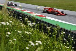 Sebastian Vettel, Ferrari SF1000, leads Kimi Raikkonen, Alfa Romeo Racing C39