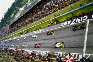 The grid is lined up for the start. Ayrton Senna, Lotus 97T Renault, and Keke Rosberg, Williams FW10 Honda, Elio de Angelis, Lotus 97T Renault, Michele Alboreto, Ferrari 156/85