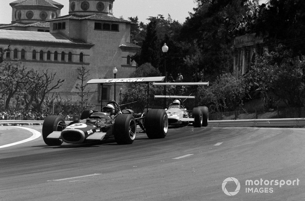 Pedro Rodriguez, BRM P126, leads Denny Hulme, McLaren M7A Ford