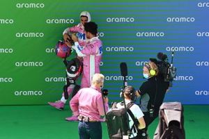 Lance Stroll, Racing Point, and Sergio Perez, Racing Point, talk after Qualifying
