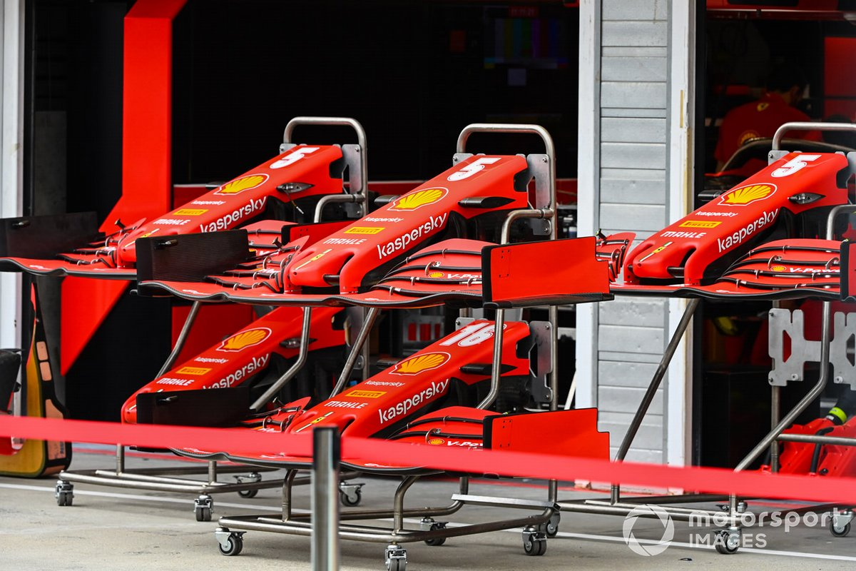 Ferrari nose coses and front wings in the pit lane