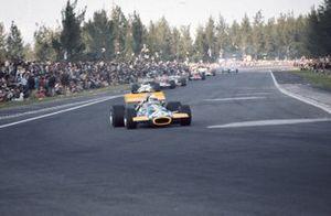 Jack Brabham, Brabham BT33 Ford, leads Pedro Rodriguez, BRM P153