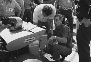 Tim Parnell and Ron Tauranac inspect the back of Pedro Rodriguez's B.R.M. P153 in the pits