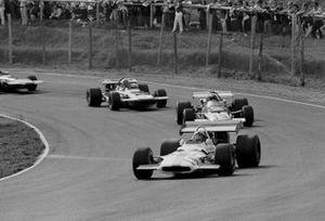 Pedro Rodriguez, BRM P153, leads Clay Regazzoni, Ferrari 312B, and Francois Cevert, March 701
