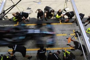 The Mercedes team practise a pit stop