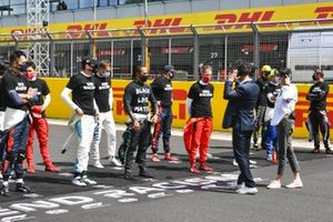 Lewis Hamilton, Mercedes-AMG F1, and the other drivers assemble to show their support for the End Racism campaign