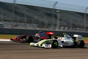 Rubens Barrichello, Brawn GP BGP001 Mercedes battles with Heikki Kovalainen, McLaren MP4-24 Mercedes